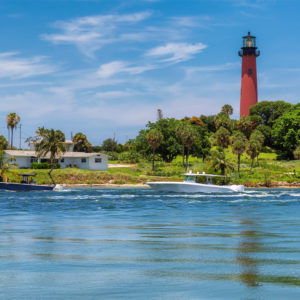 Local boaters cruising in front of the Jupiter Lighthouse on the Loxahatchee River in Jupiter, Fl.